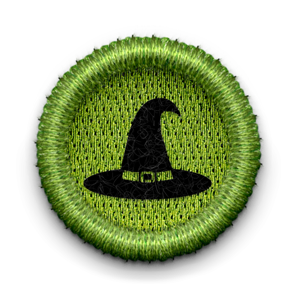Witch hat badge with link leading to Spookamaga page