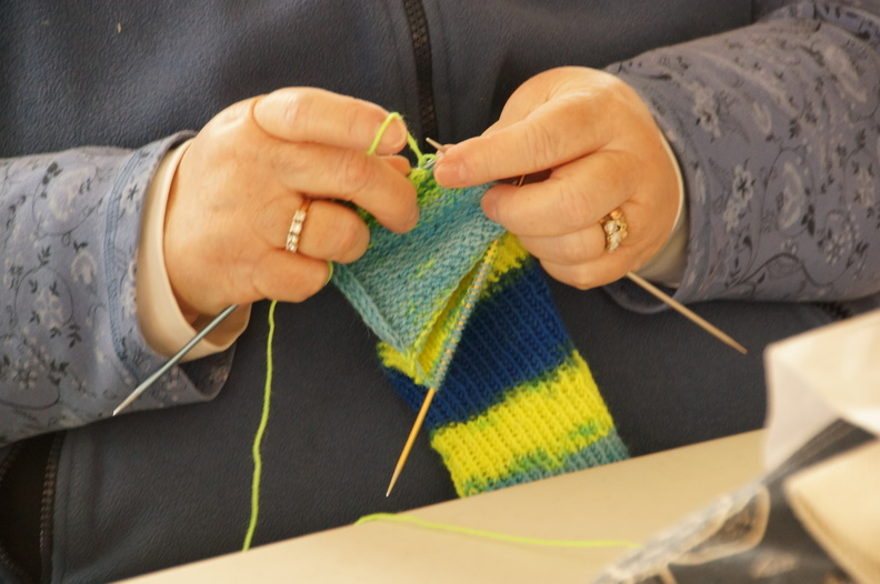 Hands knitting a scarf